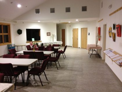Our Fellowship Hall: notice the pass-through window to the kitchen. Children's Religious Education rooms are straight ahead and down the hall.
